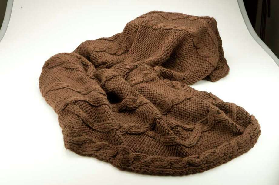 Martha stewart chunky cable blanket, brown. Photographed Wednesday, Nov. 10, 2010, in the Chronicle studio in Houston.  ( Nick de la Torre / Houston Chronicle ) Photo: Nick De La Torre, Staff / Houston Chronicle