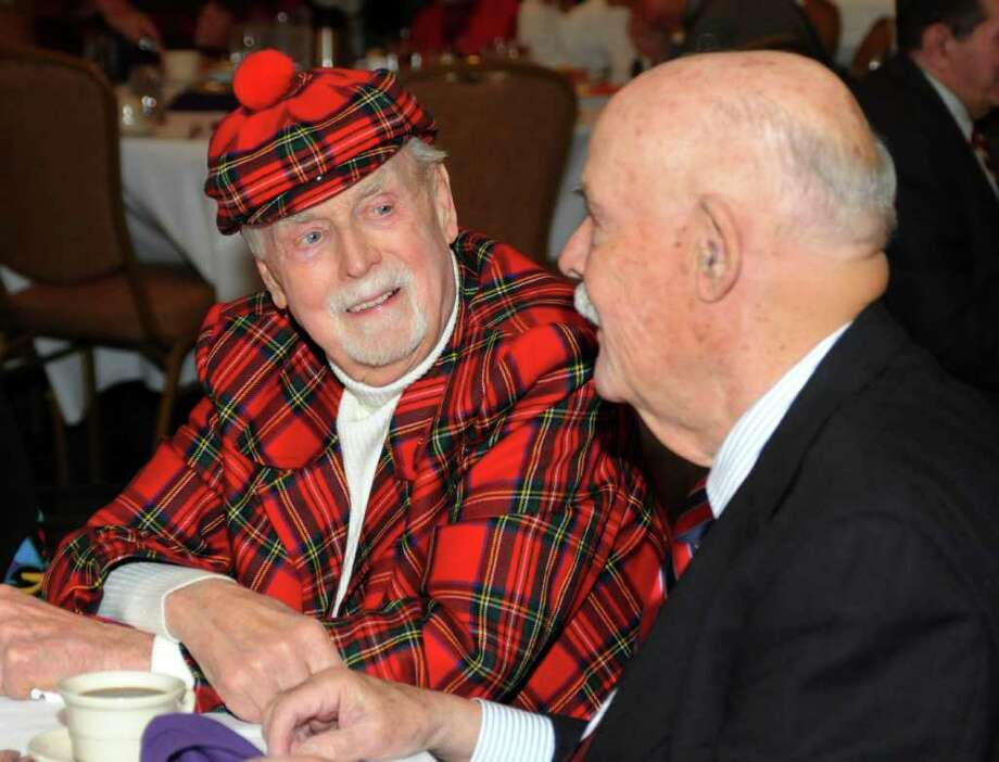 The Danbury Lions Club held it's annual luncheon at the Holdiay Inn on Thursday, Dec. 9, 2010. Ed Wicks, of Danbury, chats with Miquel Espinosa, also of Danbury. Photo: Lisa Weir / The News-Times Freelance