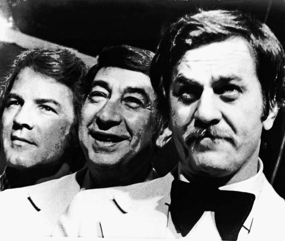 FILE - This Nov. 20, 1973, file photo shows, from left, Frank Gifford, Howard Cosell and Don Meredith, before the start of their ABC-TV football telecast, in Atlanta, Georgia. Meredith died in Santa Fe, N.M., after suffering a brain hemorrhage and lapsing into a coma, on Sunday, Dec. 5, 2010. He was 72. (AP Photo/File)