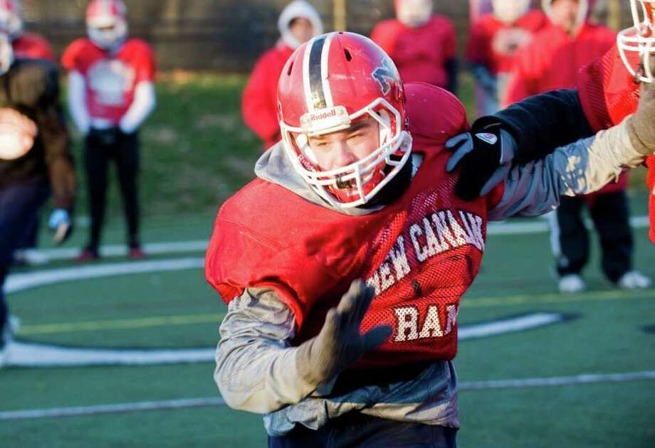 New Canaan High School's Ryan Shullman practices with the football team in New Canaan, Conn., Thursday, December 9, 2010. Photo: Keelin Daly / Stamford Advocate