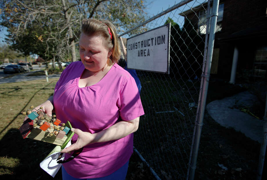 Donna LAnier shows toys that were recovered from her family's burned rental home in Schertz. Her family was devestated by the fire on Nov. 18, but that day and in the days since, the San Antonio Area Chapter of the American Red Cross has helped them, just as it helps many victims of disaster. Photo: Kin Man Hui/kmhui@express-news.net