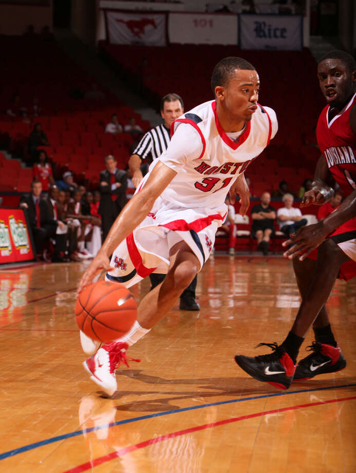 Senior Adam Brown says he loves a good challenge on the court, and he's proven it by working to improve every facet of his game. He's been rewarded with ample playing time. Photo: COURTESY PHOTO/UNIVERSITY OF HOUSTON