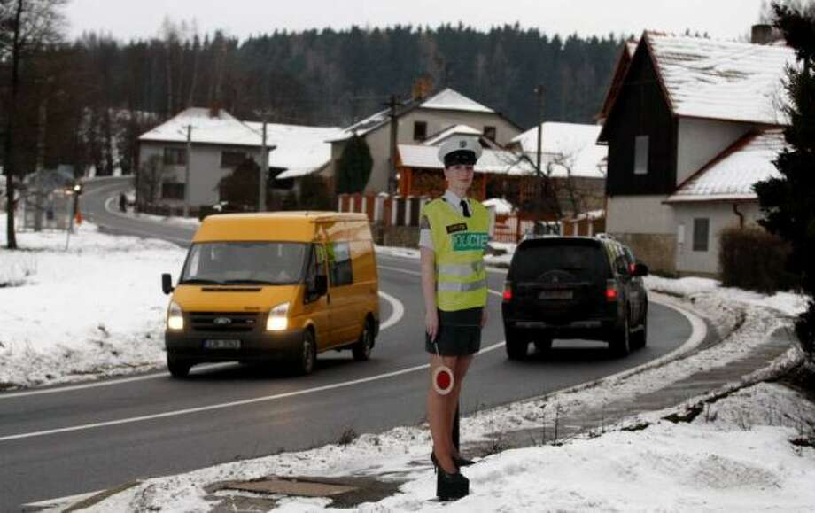 A cardboard police officer in a mini skirt is displayed to slow down traffic in the village of Myslotin, central Czech Republic, on Thursday.