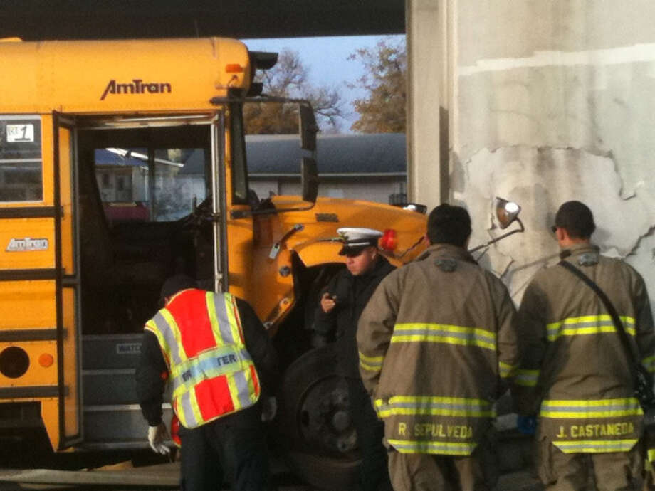 San Antonio fire and police officials investigate a bus crash that injured  the driver and four students Friday morning. (Bob Owen, rowen@express-news.net)