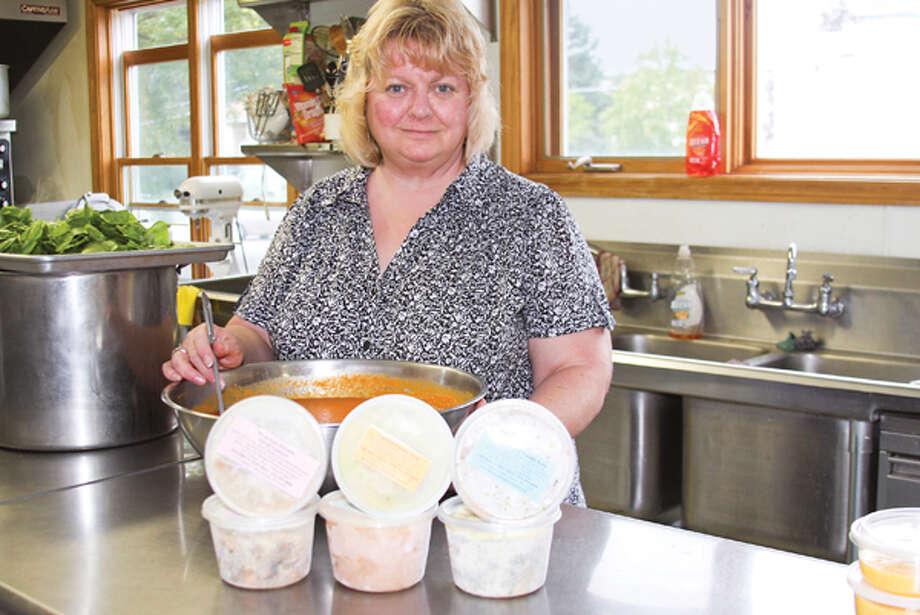 Sherry Lindsey shows off just a few of the 350 soups at her command. (Paul Barrett/Life@Home)