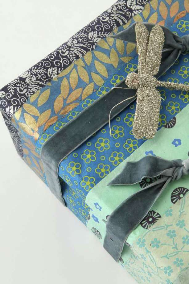 Anthropologie's gift wrap collection includes beautiful papers, ribbons and glittery dragonflies. www.anthroplogie.com / DirectToArchive