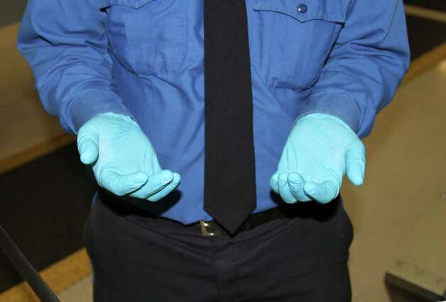 A fresh pair of TSA latex gloves at the San Antonio International Airport. Photograph by Forest M. Mims III. Photo: FORREST M MIMS 111
