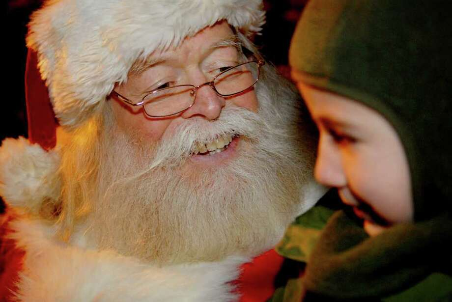Brady Sicotte, 5, has an important meeting with Santa Claus Wednesday, Dec. 8, 2010, at the Upper Union Street Business Improvement District's tree lighting ceremony in Schenectady. (Luanne M. Ferris / Times Union ) Photo: Luanne M. Ferris