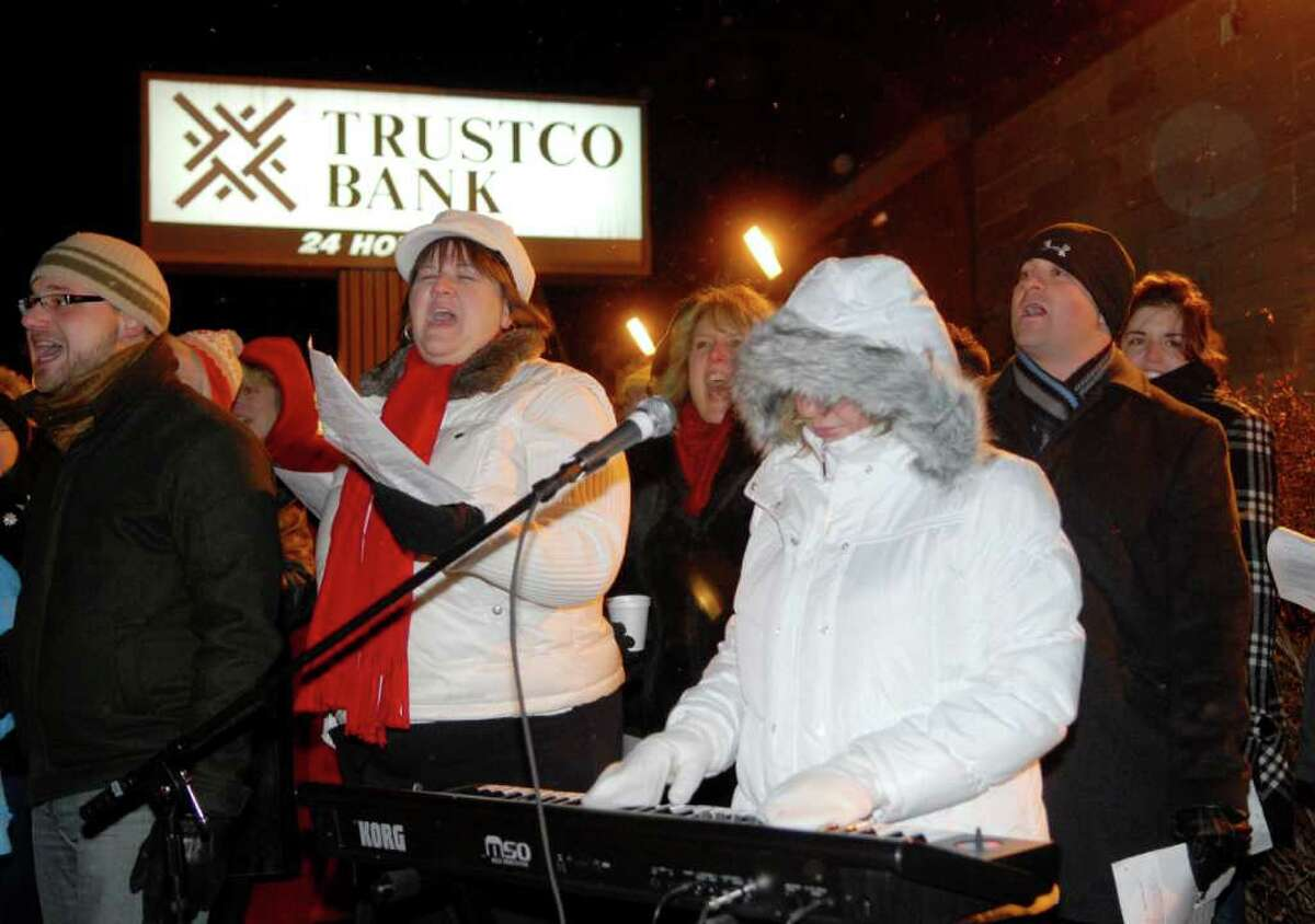 Despite the freezing temperatures, members of the Calvary Tabernacle Choir sing holiday carols with those assembled for a tree lighting sponsored by the Upper Union Street Business Improvement District in Schenectady, NY, on Wednesday, Dec. 8, 2010. (Luanne M. Ferris / Times Union )