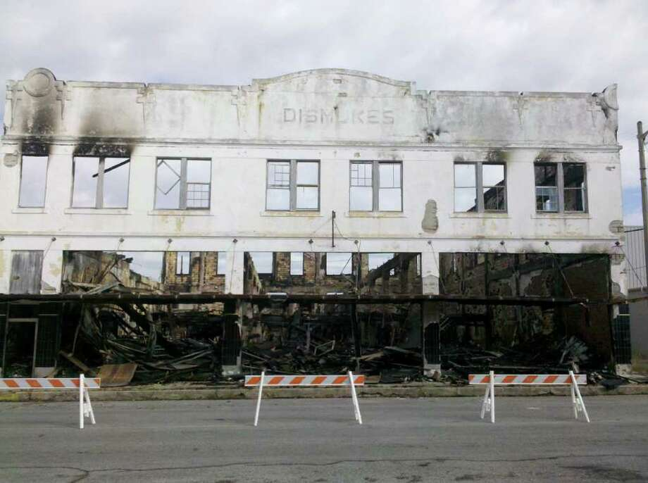 A man's body was found Friday morning in a former furniture store that burned Tuesday.  Teresa Mioli/The Enterprise