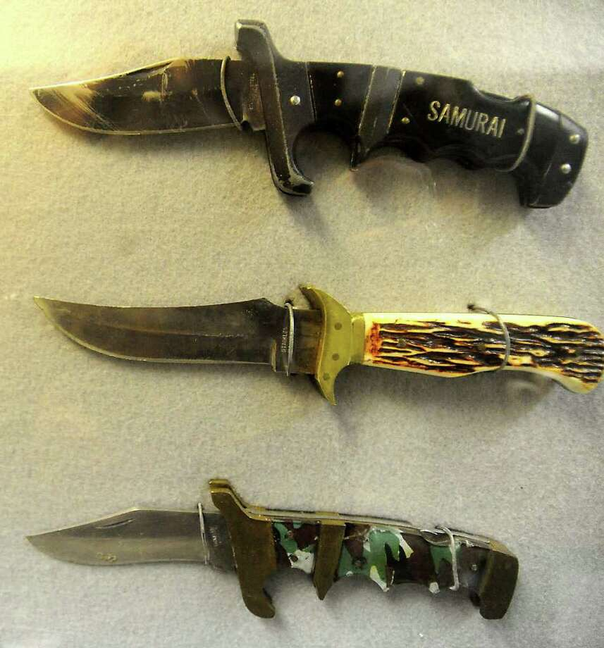 Confiscated knives of a variety of sizes are on display at the Beaumont Police Department in Beaumon. Recent changes in knife carrying laws in other states indicate that the laws may be challenged in Texas. Tammy McKinley/The Enterprise Photo: TAMMY MCKINLEY / Beaumont