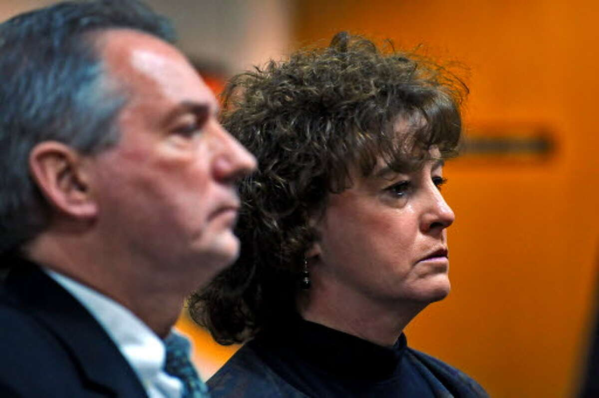 Dr. Eileen Joyce, right, and her attorney Joe McCoy, left, stand before Guilderland Town Justice Denise Randall for Joyce's January arraignment on a felony driving while intoxicated charge. (PHILIP KAMRASS / TIMES UNION)