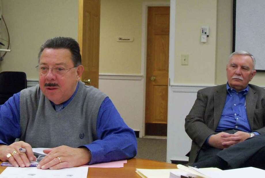 Assessor Thomas Browne, left explains the results of the recent townwide property revaluation, while Tax Collector Stanley Gorzelany looks on. Photo: Genevieve Reilly / Fairfield Citizen