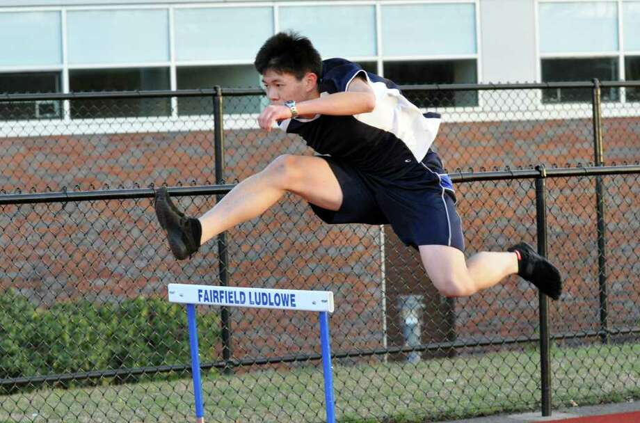 Fairfield Ludlowe boys track George He during practice Photo: Amy Mortensen / Connecticut Post Freelance