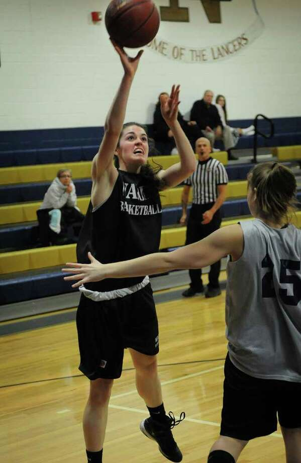 Fairfield Warde's Meghan Kerrigan shoots over Notre Dame of Fairfield's Tory Wainwright during a scrimmage on Monday, December 6, 2010. Photo: Brian A. Pounds / Connecticut Post