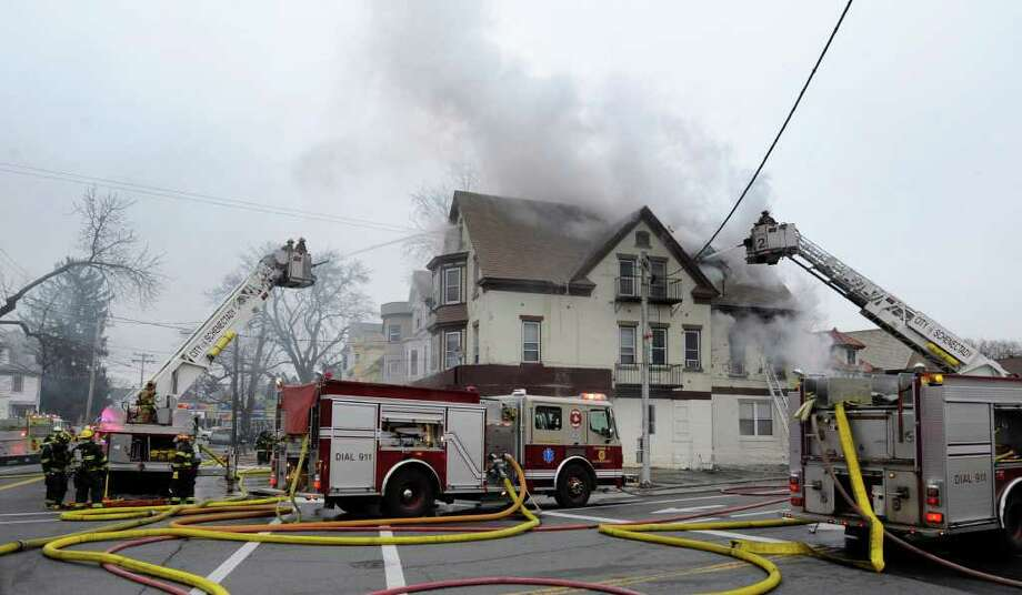Firefighters from Schenectady and surrounding communities battle a  stubborn fire at the corner of Eastern Avenue and McClellan Street in Schenectady on Friday, Dec. 10, 2010.    (Skip Dickstein / Times Union) Photo: SKIP DICKSTEIN / 2008