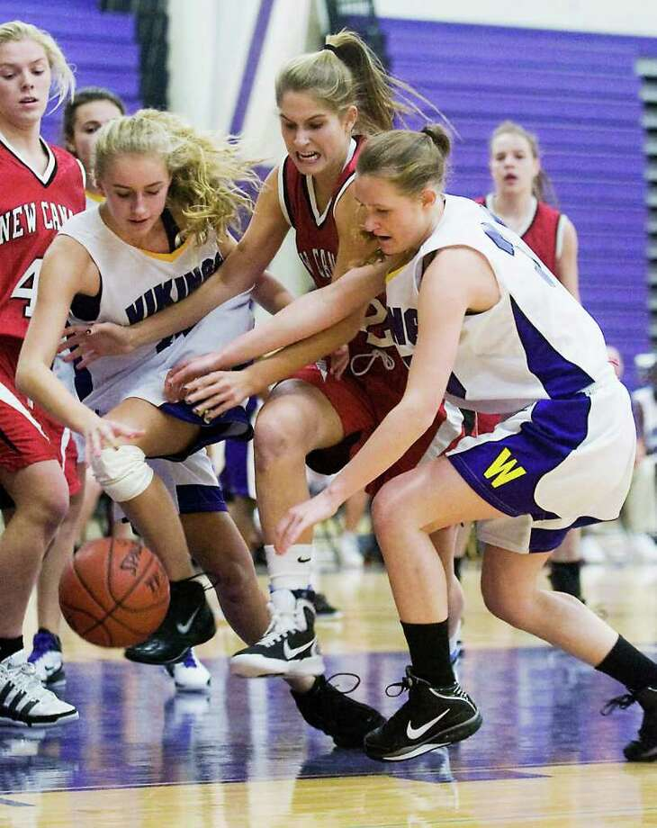 New Canaan's Christina Loop fights for control of the ball against Westhill High School's Stephanie Roones and Anne Hawthorn in girls basketball action in Stamford, Conn. on Friday December 10, 2010. Photo: Kathleen O'Rourke / Stamford Advocate