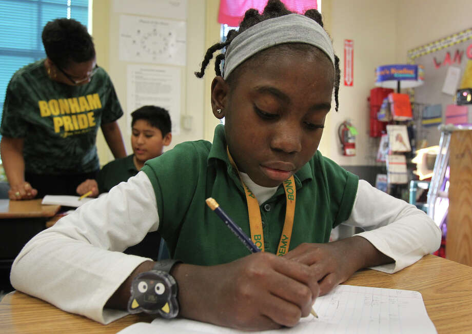Bethlie Paul, displaced by the quake in Haiti, studies at Bonham Academy. A fundraiser today aims to help build a new home for Paul's family. Photo: John Davenport/Express-News