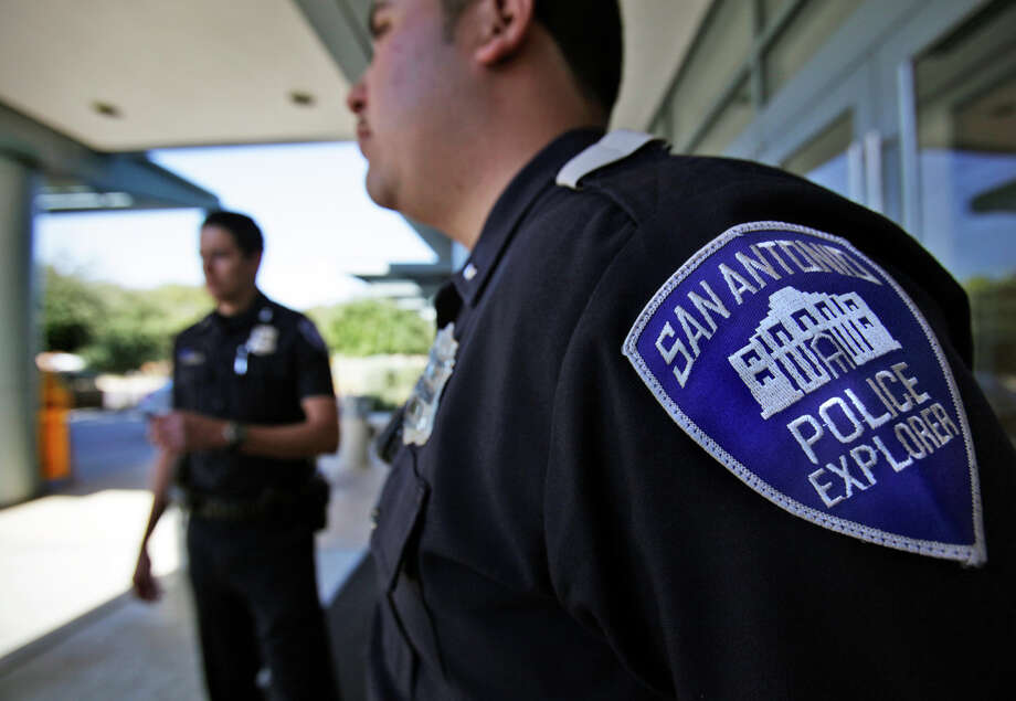 Police Explorer Lt. Sam Gallegos (right) and Chief Justin Sanchez patrol the entrance to The Shops at La Cantera. The Explorers program is designed for aspiring police officers. Photo: Bob Owen/rowen@express-news.net / SAN ANTONIO EXPRESS-NEWS