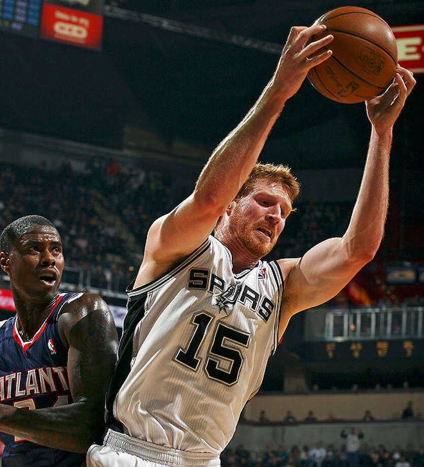 The Spurs' Matt Bonner grabs a rebound in front of the Hawks' Marvin Williams during first-half action Friday, Dec. 10, 2010 at the AT&T Center. (PHOTO BY EDWARD A. ORNELAS/eaornelas@express-news.net)