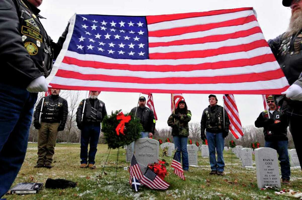 Members of the Patriot Guard Riders hold a ceremony at the grave of an unknown Civil War soldier as part of the Wreaths Across America & Civil Air Patrol program at Saratoga National Cemetery in Schuylerville on Dec. 11. ( Michael P. Farrell/Times Union
