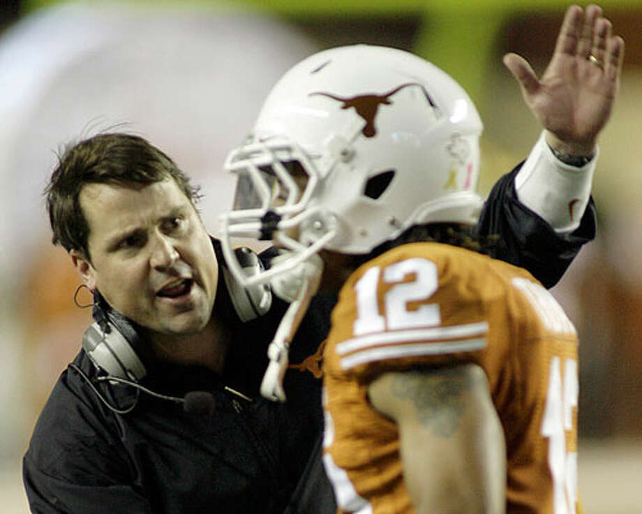 Texas defensive coordinator Will Muschamp (left) reportedly has taken the head coaching job at Florida.  HARRY CABLUCK/ASSOCIATED PRESS Photo: HARRY CABLUCK/ASSOCIATED PRESS, Express-News