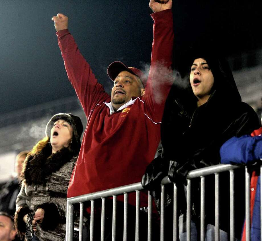 St. Joseph fans support their team during Saturday's Class S State Football Championship game at Rentschler Field in East Hartford on December 11, 2010. Photo: Lindsay Niegelberg / Connecticut Post