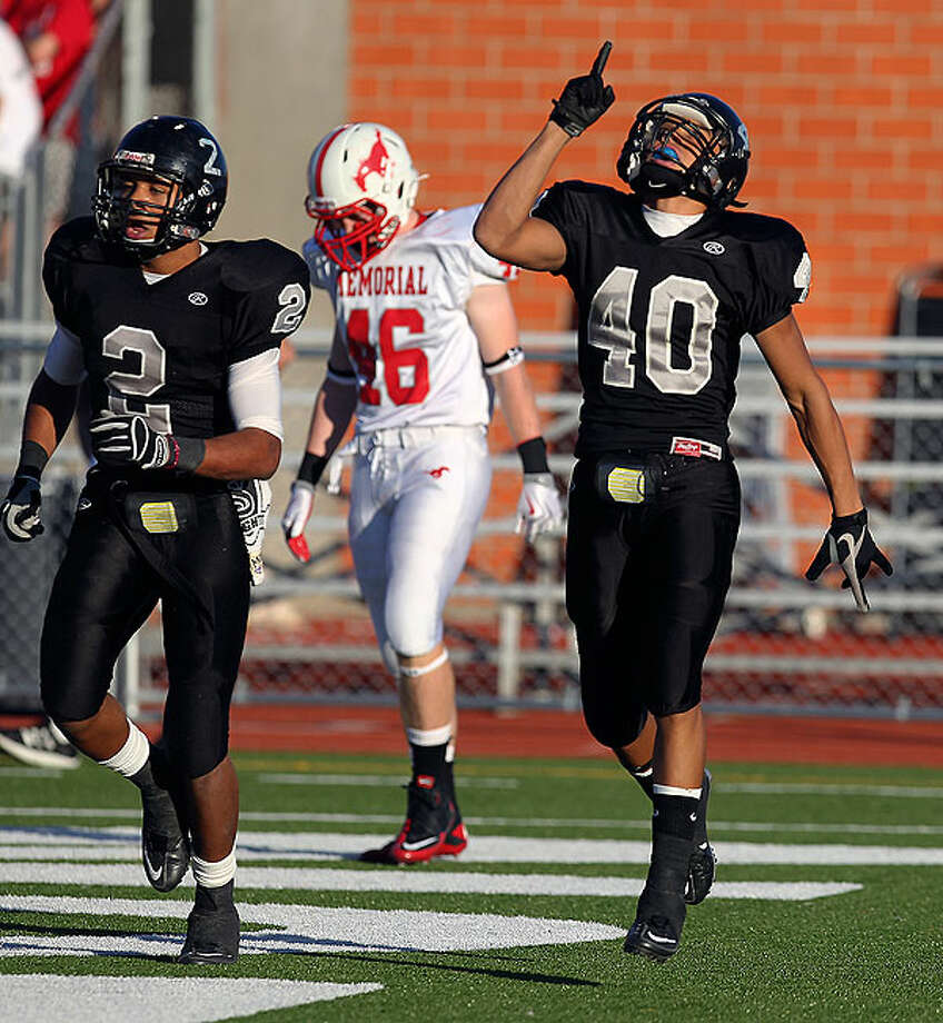Steele's Justin Stockton (40) gestures after scoring a touchdown against Houston Memorial's Brock Davidson (46) in the Class 5A Division II state semifinal football game at Heroes Stadium on Saturday, Dec. 11. 2010. Steele moved into the state championship game for the school's first time with a victory over Memorial, 44-20. Photo: Kin Man Hui/kmhui@express-news.net