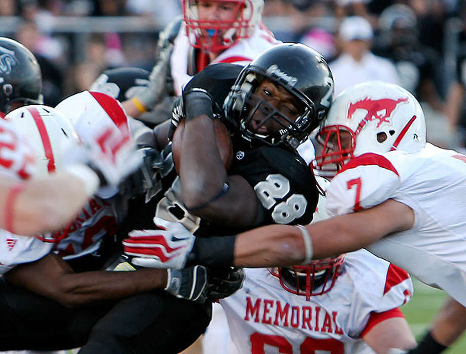 Steele's Malcolm Brown (28) collides with Houston Memorial's Tyler McCloskey (7) in the Class 5A Division II state semifinal football game at Heroes Stadium on Saturday, Dec. 11. 2010. Steele moved into the state championship game for the school's first time with a victory over Memorial, 44-20. Photo: Kin Man Hui/kmhui@express-news.net