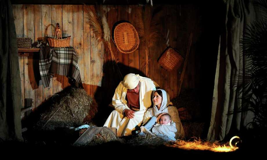 Eric Swanzy, Kim Swanzy and Ava Swanzy play the parts of Joseph, Mary and Jesus during a live Nativity performance at the Wesley United Methodist Church in Nederland, Saturday. Tammy McKinley/The Enterprise Photo: TAMMY MCKINLEY / Beaumont