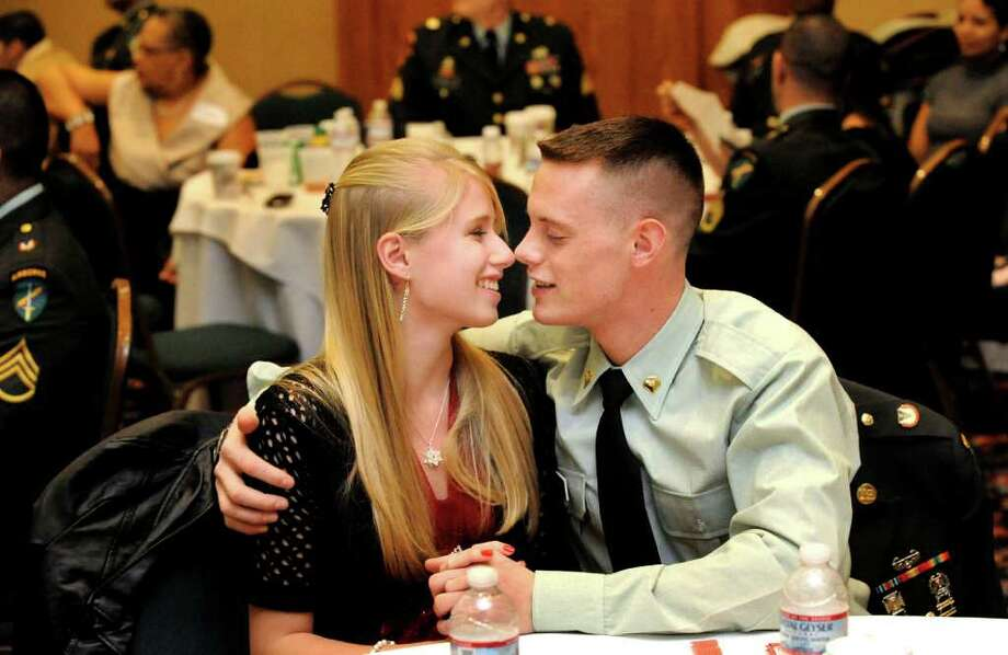 Jennifer Tichon canoodles with her boyfriend, Chris Veness, both of Newtown, who served in Iraq wih the 411 Civil Affairs Battalion, during the Welcome Home 411 Civil Affairs Battalion party at the Danbury Plaza Hotel, Saturday, Dec. 11, 2010. Photo: Michael Duffy / The News-Times