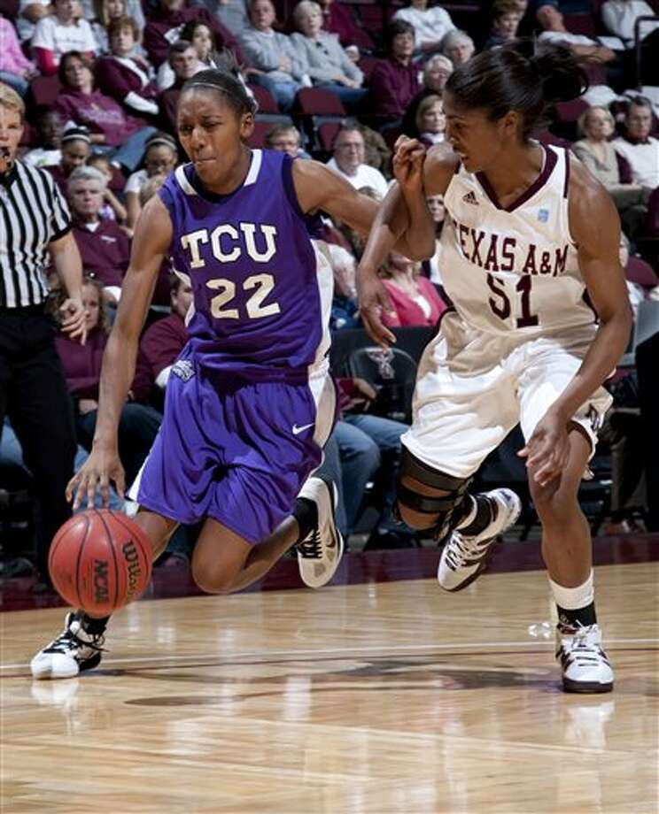 TCU forward Delisa Gross (22) drives the ball against Texas A&M's Sydney Colson (51) on Sunday in College Station. Photo: Jon Eilts/Associated Press
