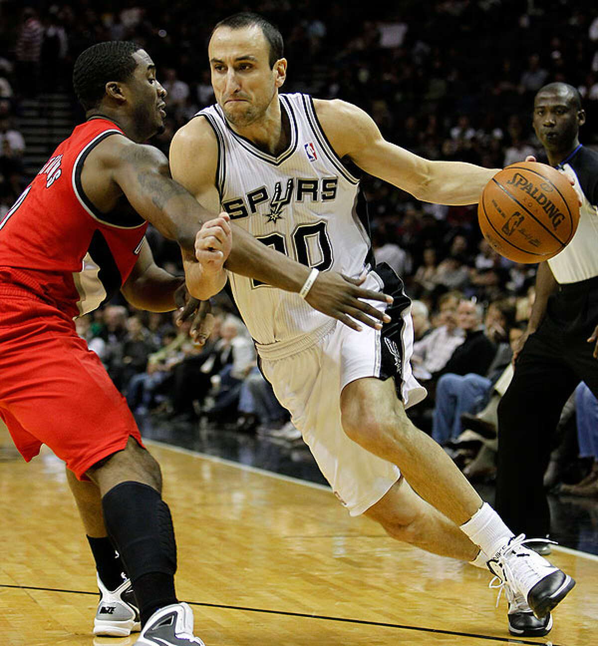 The Spurs' Manu Ginobili drives to the basket against the Trail Blazers' Wesley Matthews on Sunday.