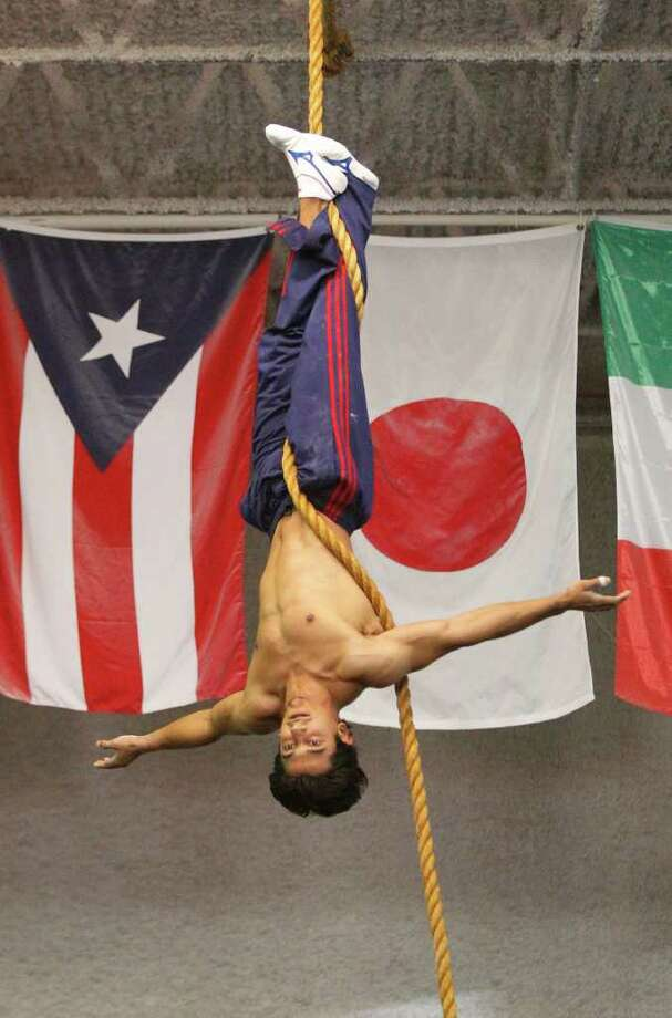 Raj Bhavsar, a 2008 U.S. Olympic gymnastics bronze medalist, works out  at Houston Gymnastics Academy. He is about to join Cirque du Soleil. Photo: Melissa Phillip, Staff / Houston Chronicle