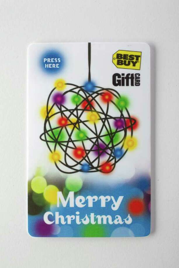 (CUTOUT) A Best Buy gift card that lights up. Gift cards are the holiday sales trend Wednesday, Dec. 8, 2010, in Houston. ( Johnny Hanson / Houston Chronicle ) Photo: Johnny Hanson, Staff / Houston Chronicle
