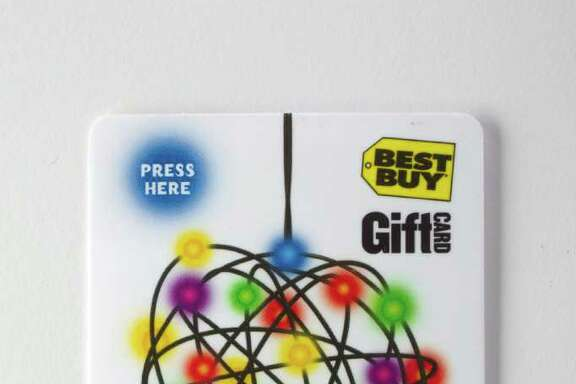 (CUTOUT) A Best Buy gift card that lights up. Gift cards are the holiday sales trend Wednesday, Dec. 8, 2010, in Houston. ( Johnny Hanson / Houston Chronicle )