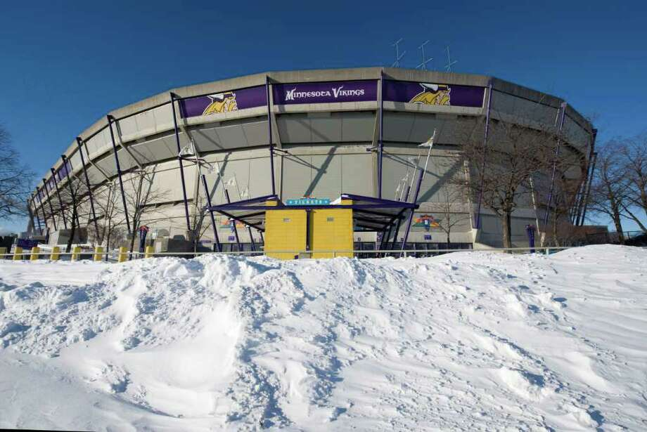 MINNEAPOLIS, MN - DECEMBER 12:  Snow surrounds the Hubert H. Humphrey Metrodome, Mall of America Stadium where the inflatable roof collapsed under the weight of snow during a storm Sunday morning December 12, 2010 in Minneapolis, Minnesota. A blizzard dumped more than 20 inches of snow in parts of the Midwest forcing the NFL football game between the New York Giants and the Minnesota Vikings to be postponed till Monday and will be played in Detroit's Ford Field. There were no injuries reported from the collapse of the dome.  (Photo by Tom Dahlin/Getty Images) Photo: Tom Dahlin, Getty Images / 2010 Getty Images