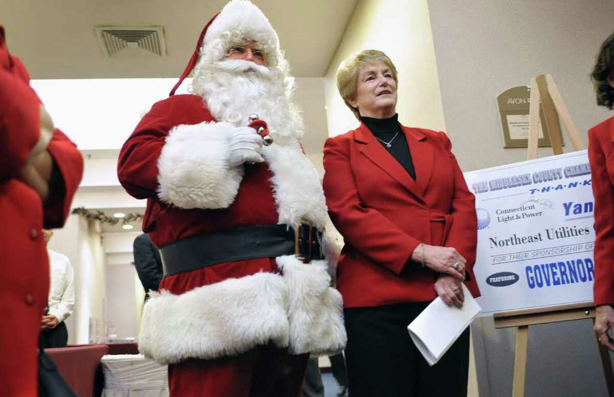 Connecticut Gov. M. Jodi Rell waits to be introduced while standing next to Santa at the Middlesex County Chamber of Commerce Breakfast in Cromwell, Conn., Monday, Dec. 13, 2010. (AP Photo/Jessica Hill)