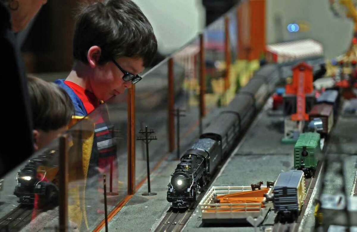 Walker Pedinotti, 7, watches a display built by Upstate Train Associates at the Schenectady Museum on Sunday, Dec. 12, 2010. (Philip Kamrass / Times Union)