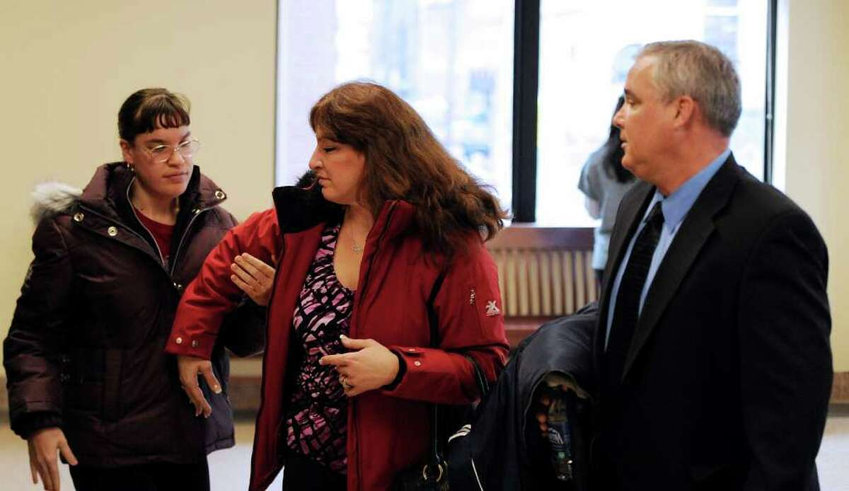 From left; Richard Bailey's sister, Katie, and his parents, Lisa and Jim, leave acting state Supreme Court Judge Dan Lamont's courtroom in the Albany County Judicial Center in Albany after summations in the trial of De Von Calllicutt, the Albany man accused of killing Bailey, a University at Albany senior in October 2008. (Skip Dickstein / Times Union)