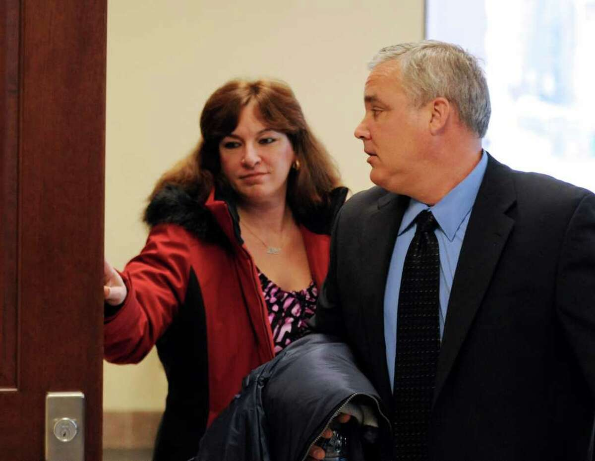 Richard Bailey's parents, Lisa and Jim, leave acting state Supreme Court Judge Dan Lamont's courtroom in the Albany County Judicial Center in Albany after summations in the trial of De Von Calllicutt, the Albany man accused of killing Bailey, a University at Albany senior, in October 2008. (Skip Dickstein / Times Union)