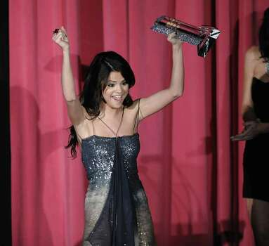Actress Selena Gomez cheers actor and award recipient Cory Monteith at the 2010 Hollywood Style Awards in Los Angeles on Sunday, Dec. 12, 2010. (AP Photo/Dan Steinberg) Photo: Dan Steinberg