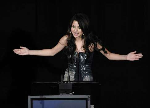Actress Selena Gomez presents an award at the 2010 Hollywood Style Awards in Los Angeles on Sunday, Dec. 12, 2010. (AP Photo/Dan Steinberg) Photo: Dan Steinberg