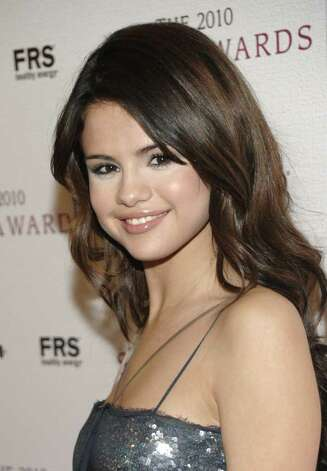Actress Selena Gomez arrives at the 2010 Hollywood Style Awards in Los Angeles on Sunday, Dec. 12, 2010. (AP Photo/Dan Steinberg) Photo: Dan Steinberg