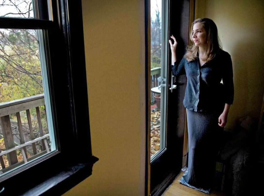 "Laura Hillenbrand, in her Washington home, says she copes with her chronic fatigue illness by detaching herself completely from aspirations. ""I hardly ever listen to music anymore because it arouses all of this yearning in me,"" she says. Illustrates HILLENBRAND (category e) by Monica Hesse (c) 2010, The Washington Post. Moved Monday, Nov. 29, 2010. (MUST CREDIT: Washington Post photo by Bill O'Leary) Photo: O'LEARY, STF / THE WASHINGTON POST"