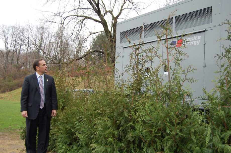 Greenwich First Selectman Peter Tesei walks past the Western Greenwich Civic Center's new emergency generator on Monday. The generator was obtained with federal Homeland Security funds. The civic center serves as one of the town's two emergency shelters, along with Eastern Middle School. It can accommodate 225 as a shelter and up to 350 individuals if it's used as a warming or cooling center. (Photo by Lisa Chamoff/staff) Photo: Contributed Photo / Greenwich Time Contributed