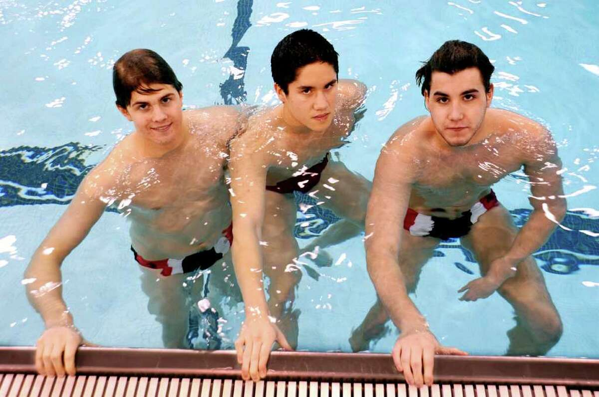 Greenwich High School's swim team captains, from left: Andrew Dillinger, Michael Dustin and Eric Minowitz, at the school pool on Monday, Dec. 13, 2010.