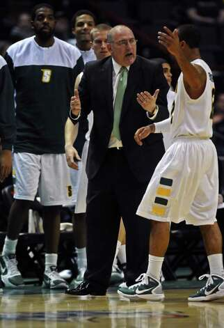 Siena coach Mitch Buonaguro yells at Rakeem Brookins, right, as the team comes off the floor at the end of the first half Monday. Siena beat Florida Atlantic 72-69 at Times Union Center. (Philip Kamrass / Times Union) Photo: Philip Kamrass