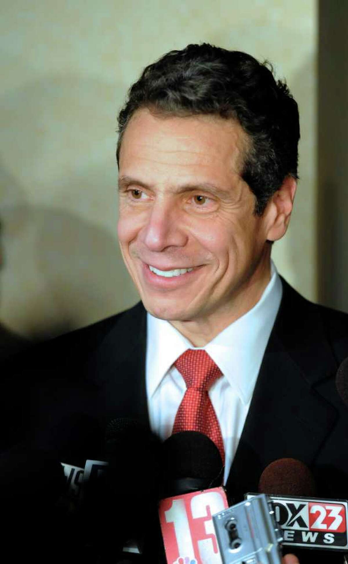 Governor Elect Andrew Cuomo is the center of attention from the media after he addressed the Democratic Conference at the Crowne Plaza in Albany November 30, 2010. (Skip Dickstein / Times Union)