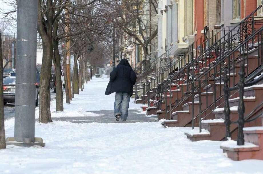 Clinton Avenue in Albany, like many roadways in the Capital Region, is blanketed in snow Tuesday morning. (Paul Buckowski / Times Union) Photo: Paul Buckowski / 00011422A